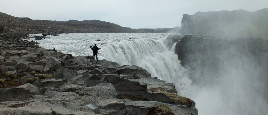 Photo of me on the edge about to take a photo of Godifoss, Iceland.